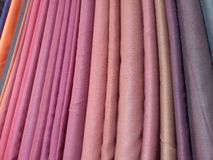 Colorful fabric clothes for sale at store Stock Photo
