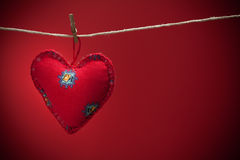 Colorful fabric hearts on red backgrounds Royalty Free Stock Photography