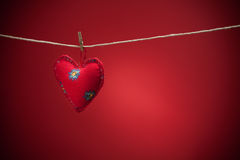 Colorful fabric hearts on red backgrounds Royalty Free Stock Image