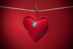 Colorful fabric hearts on red backgrounds Stock Photo