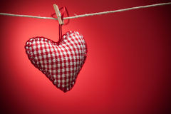 Colorful fabric hearts on red backgrounds Royalty Free Stock Images