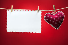 Colorful fabric hearts on red backgrounds Stock Photos