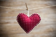 Colorful fabric hearts on wood backgrounds Royalty Free Stock Photos