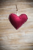 Colorful fabric hearts on wood backgrounds Royalty Free Stock Images