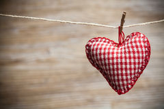 Colorful fabric hearts on wood backgrounds Royalty Free Stock Photography