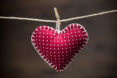 Colorful fabric hearts on wood backgrounds Stock Photo