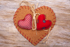 Colorful fabric hearts on wooden backgrounds Royalty Free Stock Photos