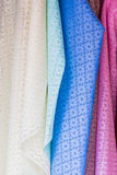 Colorful of fabric Lace rolls. Royalty Free Stock Photo