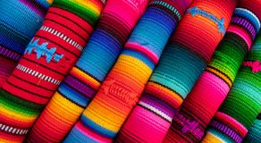 Colorful fabric from the market. A pile of color full fabric as seen on the market of mexico and guatemala stock photography
