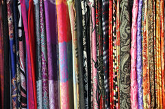 Colorful fabric pieces. At a market Royalty Free Stock Images