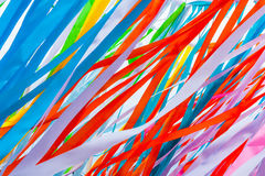 Colorful fabric ribbons wave in the wind. Play of red, blue, pink and other colors. Abstract pattern or texture Royalty Free Stock Images
