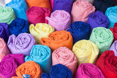 Colorful fabric rolls. Focus on front of rolls stock image