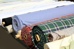 Colorful fabric rolls row in market shop Royalty Free Stock Photos