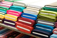Colorful fabric rolls on textile market -. Colorful fabric rolls on textile market colorful fabric rolls on textile market stock photo