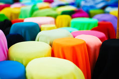 Colorful fabric in a row. In vintage fabric shop stock photography