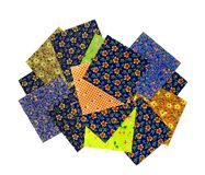 Variety of colorful fabric samples. Colorful fabric samples for a quilting project or other craft projects Stock Photo