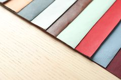 Colorful fabric samples. On wooden background Stock Photos