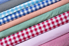 Colorful fabric scarves in stack. As background Stock Photo