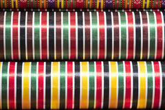 Colorful fabric scarves in stack. As background Royalty Free Stock Image