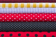Colorful fabric scarves in stack. As background Royalty Free Stock Photo