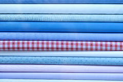 Colorful fabric scarves in stack. As background Stock Images