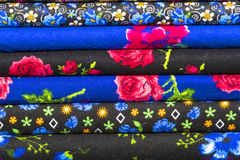 Colorful fabric scarves in stack. As background Stock Photos
