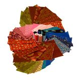 Colorful fabric squares with yar. Colorful coton squares for quilting with thread on a white background Stock Photo