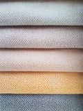 Colorful fabric stacks detail view close up Stock Photography