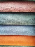 Colorful fabric stacks detail view close up Royalty Free Stock Images