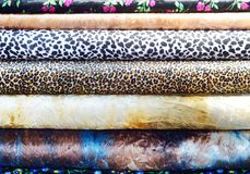 Colorful fabric stock. Colorful  fabric rolls in the shop , closeup Stock Photos