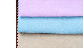 Colorful fabric swatches. On isolated studio stock photos