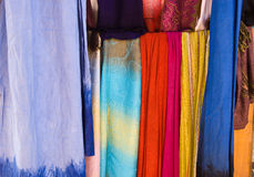 Colorful Fabrics. Selection of wonderfully bright colourful cloth at a market stall in Marrakesh Royalty Free Stock Photography