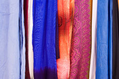 Colorful Fabrics. Selection of wonderfully bright colourful cloth at a market stall in Marrakesh Royalty Free Stock Photo