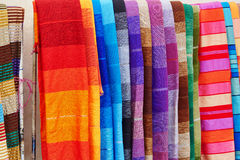 Colorful fabrics and carpets for sale in Morocco Stock Images