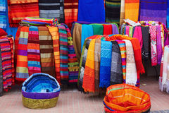 Colorful fabrics and carpets for sale in Morocco Royalty Free Stock Photos