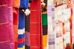 Colorful fabrics and carpets for sale in Morocco Royalty Free Stock Photography