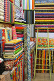 Colorful Fabrics with different patterns in a stor Stock Image
