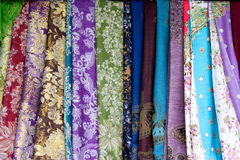 Colorful Fabrics 2. Many Colorful fabrics hang on the wall at the Chinese market stock photography