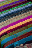 Colorful Fabrics 1. Many Colorful fabrics lay on the table at the Chinese market stock photos