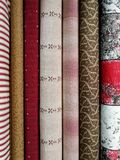 Colorful fabrics for patchwork. In vertical stock photos