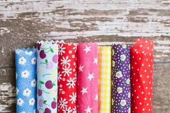 Colorful fabrics. Rolls of colorful patterned fabric Royalty Free Stock Image