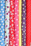 Colorful fabrics. Rolls of colorful patterned fabric Royalty Free Stock Images
