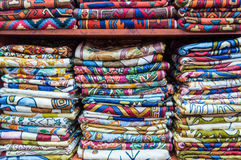 Colorful fabrics on sale in a shop Muttrah Souk, in Muttrah, Muscat, Oman, Middle East Royalty Free Stock Images