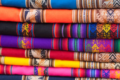 Colorful fabrics. Stack of colorful fabric rags on market display in Peru, South America Royalty Free Stock Photo