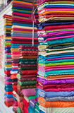 Colorful fabrics in the store Stock Images