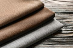 Colorful fabrics on wooden table, Royalty Free Stock Images