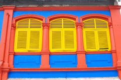 Unique traditional colorful windows in Little India, Singapore. Colorful facade of building in Little India, Singapore which is deep in traditional culture value Royalty Free Stock Photo