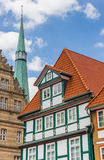 Colorful facade and church tower in Hameln Stock Photo