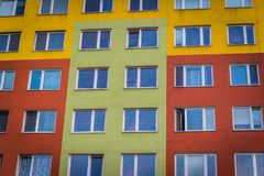 Colorful facade of high modern apartment building royalty free stock images