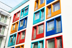 Colorful facade of modern apartment building. Colorful facade of a modern apartment building, symbol of housing, rental, anonymity, city Royalty Free Stock Photos